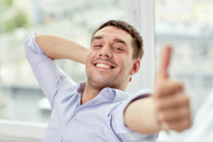smiling man giving thumbs up