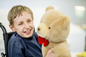 smiling child and teddy bear