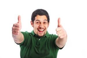smiling man giving two thumbs up