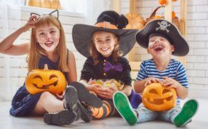 A group of children dressed in Halloween costumes.