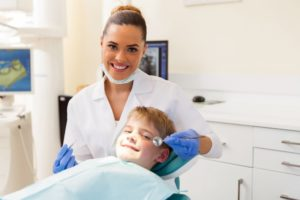 a young boy with a pediatric dentist