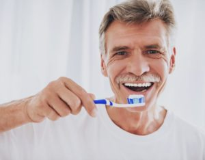 man about to brush his teeth