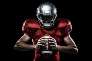 football player holding a helmet