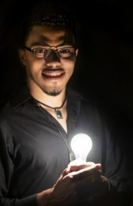 Dr. Henry holding light bulb