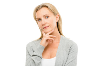 woman with finger on chin thinking