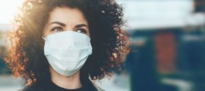 Woman wears face mask correctly as instructed by Pleasant Grove dentist