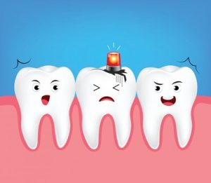 Cartoon of three teeth, the one in the middle has a siren light and a sad face