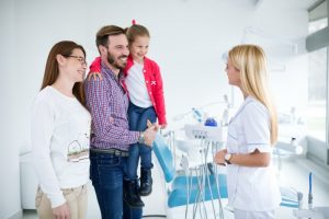 family visiting dentist in far north Dallas
