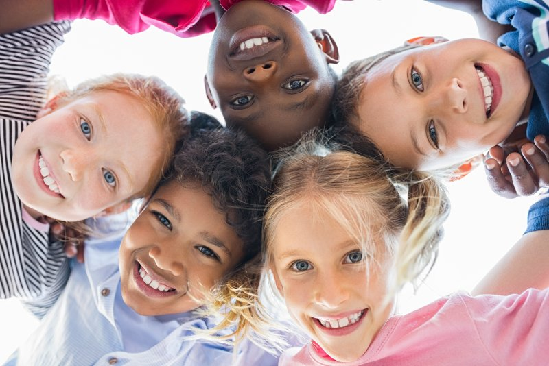 children smiling in circle oral health